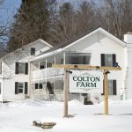 Colton farm sign and building in winter